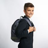 Happy schoolboy with schoolbags Royalty Free Stock Photo