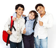 Happy schoolboys. With thumbs up, back to school, boys best friends and classmates hugging, smiling, isolated on white background, teenage education concept Stock Photography