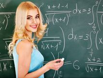 Schoolchild writing on blackboard. Royalty Free Stock Photography