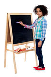 Happy schoolchild writing on blackboard Royalty Free Stock Image