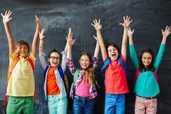 happy schoolchildren Arkivbild