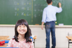 Happy schoolchildren in class with teacher Royalty Free Stock Photo