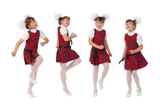 Happy schoolgir. L jumping on a white background Royalty Free Stock Photography