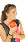 Happy Schoolgirl. Smiling girl holding notebook and apple. Isolated on white Royalty Free Stock Photo