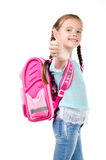 Happy schoolgirl with backpack and finger up Stock Photo