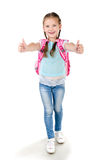 Happy schoolgirl with backpack and fingers up Stock Photography