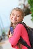 Happy schoolgirl with backpack Stock Photography