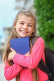 Happy schoolgirl with backpack Stock Images