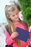 happy schoolgirl with backpack Royalty Free Stock Photography