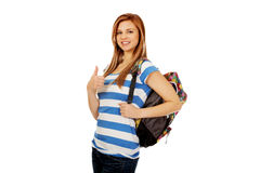 Happy schoolgirl with backpack and thumb up.  Royalty Free Stock Image