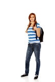 Happy schoolgirl with backpack and thumb up Stock Images