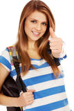 Happy schoolgirl with backpack and thumb up Stock Image