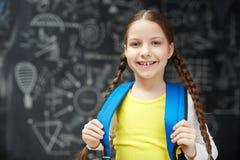 Happy Schoolgirl With Braids Posing Against Blackboard Stock Images