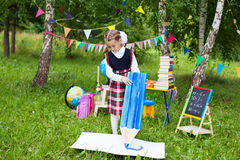 Happy schoolgirl child kid girl drawing writing with a huge big Royalty Free Stock Photography
