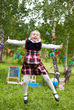 Happy schoolgirl child kid girl jumping and smiling, classroom o Royalty Free Stock Photo