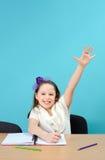 Happy schoolgirl doing her school work Stock Image