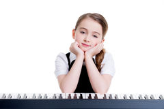 Happy schoolgirl with electric piano. Stock Images