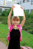 Happy schoolgirl with graduation certificate Stock Image