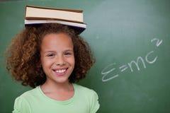 Happy Schoolgirl Holding Her Book On Her Head Royalty Free Stock Photos