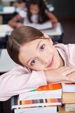 Happy Schoolgirl Leaning On Stack Of Books Stock Photos