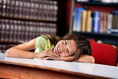 Happy Schoolgirl Looking Away While Leaning On royalty free stock image