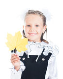 Happy schoolgirl with a maple-leaf. On a white background stock photo
