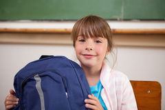 Happy schoolgirl posing with a bag Stock Photography