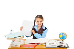 Happy schoolgirl show paper with A+ Stock Image