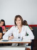 Happy Schoolgirl Sitting At Desk Royalty Free Stock Image