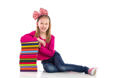 Happy schoolgirl with stack of books Royalty Free Stock Photo