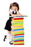 Happy schoolgirl with a stack of heavy books Royalty Free Stock Photo