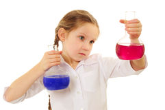 Happy schoolgirl studying chemistry Royalty Free Stock Images