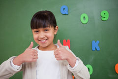 Happy schoolgirl with the thumbs up Royalty Free Stock Photos