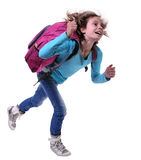 Happy schoolgirl or traveler exercising and jumping Stock Photos