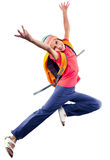 Happy schoolgirl or traveler exercising, running and jumping Royalty Free Stock Photo