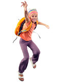 Happy schoolgirl or traveler exercising, running and jumping Royalty Free Stock Image