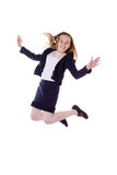Happy schoolgirl in uniform jumping Stock Photography