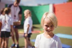Happy schoolgirl in uniform Stock Image