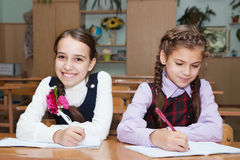 Happy schoolgirl writing Stock Photo