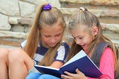 Happy schoolgirls Royalty Free Stock Image