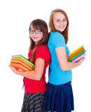Happy schoolgirls holding colorful books Stock Photo