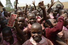 Happy schoolgirls and schoolboys in Uganda Stock Images