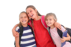 Happy schoolgirls. On a white background royalty free stock photography