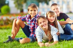 Happy schoolkids playing in the park Royalty Free Stock Photo