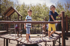 Happy schoolkids playing in playground Stock Photography