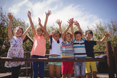 Happy schoolkids playing in playground Royalty Free Stock Photo