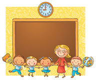 Happy schoolkids with their teacher at the blackboard Royalty Free Stock Photography