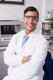 Happy scientist smiling at camera with arms crossed. In the laboratory Stock Photography