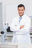 Happy scientist smiling at camera with arms crossed. In the laboratory Royalty Free Stock Images
