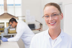 Happy scientist smiling at camera. In the laboratory Stock Photo